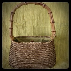 Charter club rattan purse with bamboo handle.